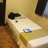 Photo taken at New Horizon Hotel by Neil E. on 3/12/2012