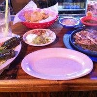 Photo taken at Ahuuas Mexican Restaurant by Krystle G. on 3/11/2012