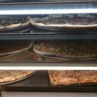 Photo taken at Justino's Pizzeria by Brett P. on 1/23/2012