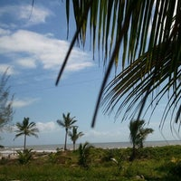 Photo taken at Praia Da Costa by Djanira B. on 12/29/2011