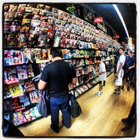 Photo taken at Midtown Comics by wallace v. on 7/21/2012