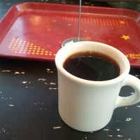 Photo taken at Flying Star Café by Andrew S. on 7/23/2012