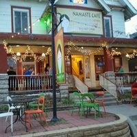 Photo taken at Namaste Cafe by Chris S. on 3/21/2012