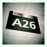 Photo taken at Gate A26 by Michal V. on 9/12/2011