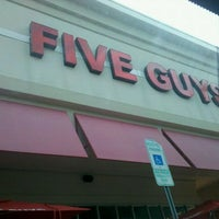 Photo taken at Five Guys by Paige S. on 1/1/2012
