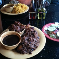Photo taken at Rice & Beans Cocina Latina by Tanya C. on 9/8/2011
