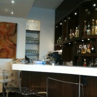Photo taken at The Centurion Lounge by American Express by Fernando A. on 4/14/2012
