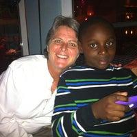 Photo taken at City Tropics Bistro by Chantelle S. on 12/15/2011