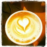 Photo taken at Café Helios by Joy M. on 6/3/2012