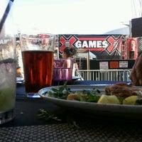 Photo taken at Wolfgang Puck Bar & Grill by Koren K. on 7/2/2012