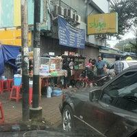 Photo taken at Bubur Ayam Shigeo by romy i. on 4/30/2012