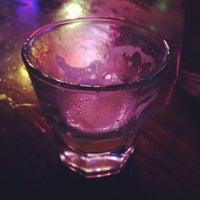 Photo taken at Revolver Bar & Lounge by Danae O. on 4/25/2012