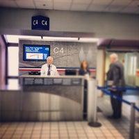 Photo taken at Gate C4 by Glenn M. on 6/19/2012