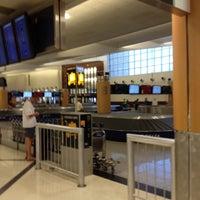Photo taken at South Baggage Claim by Matthew B. on 5/6/2012