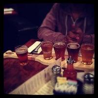 Photo taken at Biggie's Restaurant Raw Bar Tavern by Linh T. on 4/19/2012