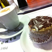 Photo taken at Café Caliente by Daniela E. on 7/30/2012