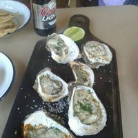 Photo taken at La Docena Oyster Bar & Grill by Carlos R. on 6/4/2012