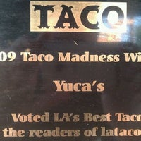 Photo taken at Yuca's Taqueria by Mark D. on 12/14/2011