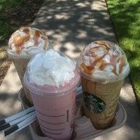 Photo taken at Starbucks by Elaine J. on 6/11/2011