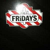 Photo taken at TGI Fridays by Loren P. on 12/12/2011
