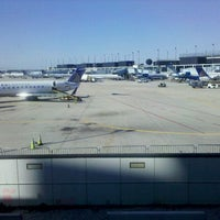 Photo taken at Gate F11 by joanne S. on 6/3/2012