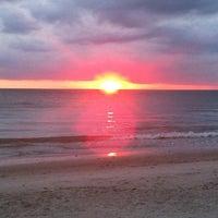 Photo taken at Vanderbilt Beach by Cherie W. on 5/20/2012