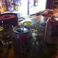 Photo taken at Mako's Bar & Grill by Colleen S. on 5/8/2011