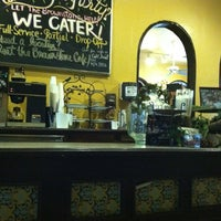 Photo taken at The Brownstone Cafe by Kelly A. on 12/4/2011