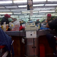 Photo taken at Sanchez Barbershop by Heriberto R. on 2/4/2012