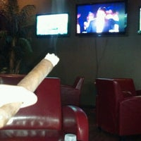 Photo taken at Cigar Oasis by Steve R. on 12/18/2011