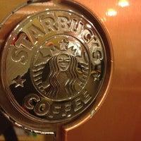 Photo taken at Starbucks by Lynx N. on 3/23/2012