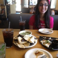 Photo taken at California Pizza Kitchen by Serena S. on 3/28/2012