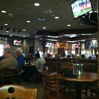 Photo taken at Champps Restaurant & Bar by Adam D. on 6/9/2012
