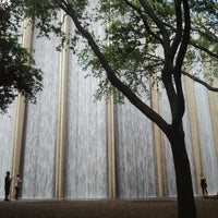 Photo taken at Gerald D. Hines Waterwall Park by Carlos S. on 4/8/2012
