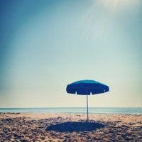 Photo taken at 81st Street Beach by Josh R. on 6/28/2012