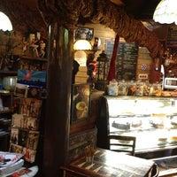 Photo taken at Three Monkeys Coffee & Tea House by Iraís L. on 6/4/2012