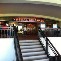 Photo taken at Regal Cinemas Atlas Park 8 by Jonathan R. on 7/4/2012