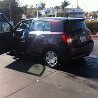 Photo taken at National City Car Wash by Margie O. on 9/6/2012