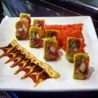 Photo taken at Sushi Garden Restaurant by Erica A. on 4/11/2012