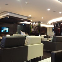 Photo taken at Etihad Airways Lounge by Chris R. on 8/5/2012