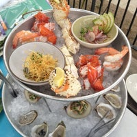 Photo taken at Perla's Seafood and Oyster Bar by Stephen T. on 5/12/2012