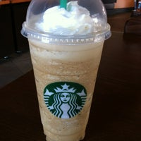 Photo taken at Starbucks by E T. on 3/26/2012