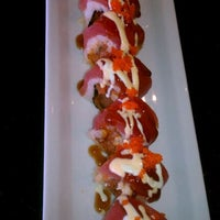 Photo taken at Sushi Eye in Motion by Kathleen S. on 3/14/2012