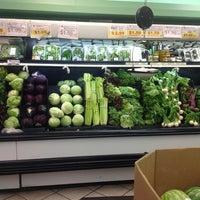 Photo taken at Nijiya Market by Laurel D. on 7/12/2012
