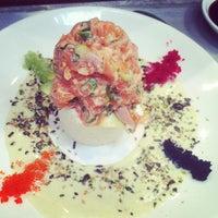 Photo taken at Sushi Zushi by Eric G. on 2/24/2012