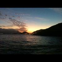 Photo taken at Praia do Sossego by Lohany V. on 6/24/2012