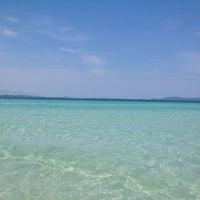 Photo taken at Ilıca Plajı by Yelda C. on 6/3/2012