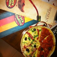 Photo taken at Divina Comédia Pizza Bar by Gustavo R. on 8/17/2012