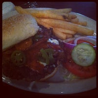 Photo taken at Bailey's Sports Grille by Amos W. on 4/13/2012