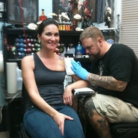 Photo taken at Black Hive Tattoo by Kat L. on 3/21/2012